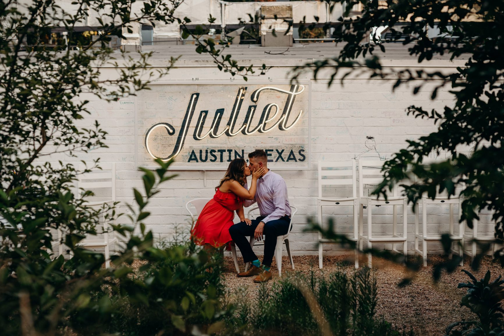 couple kissing through the leaves in front of juliet austin texas