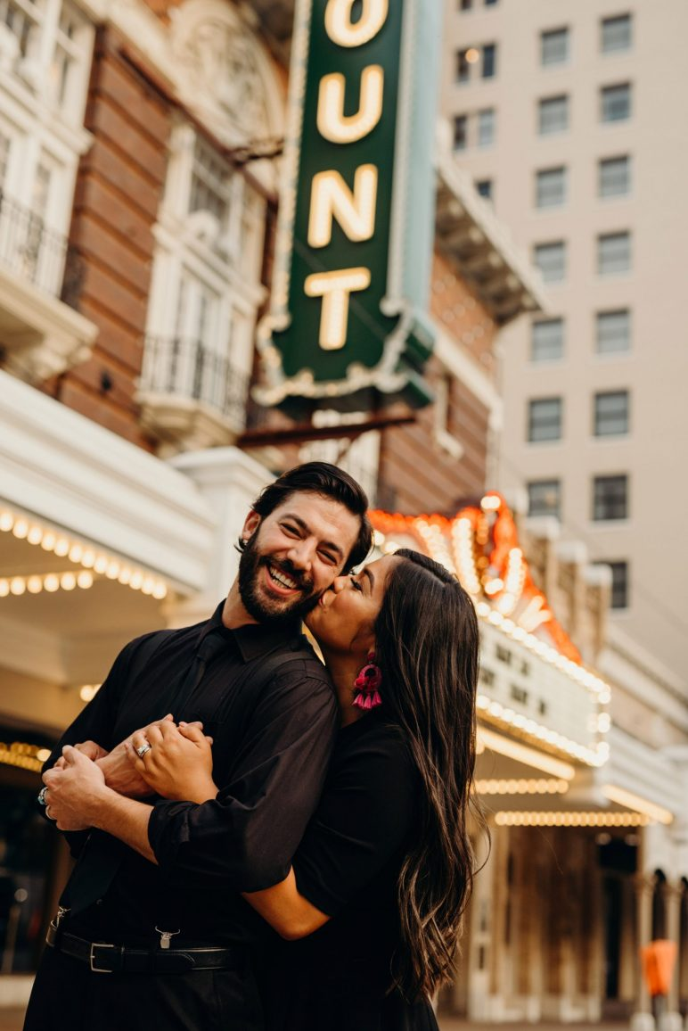couple embracing downtown