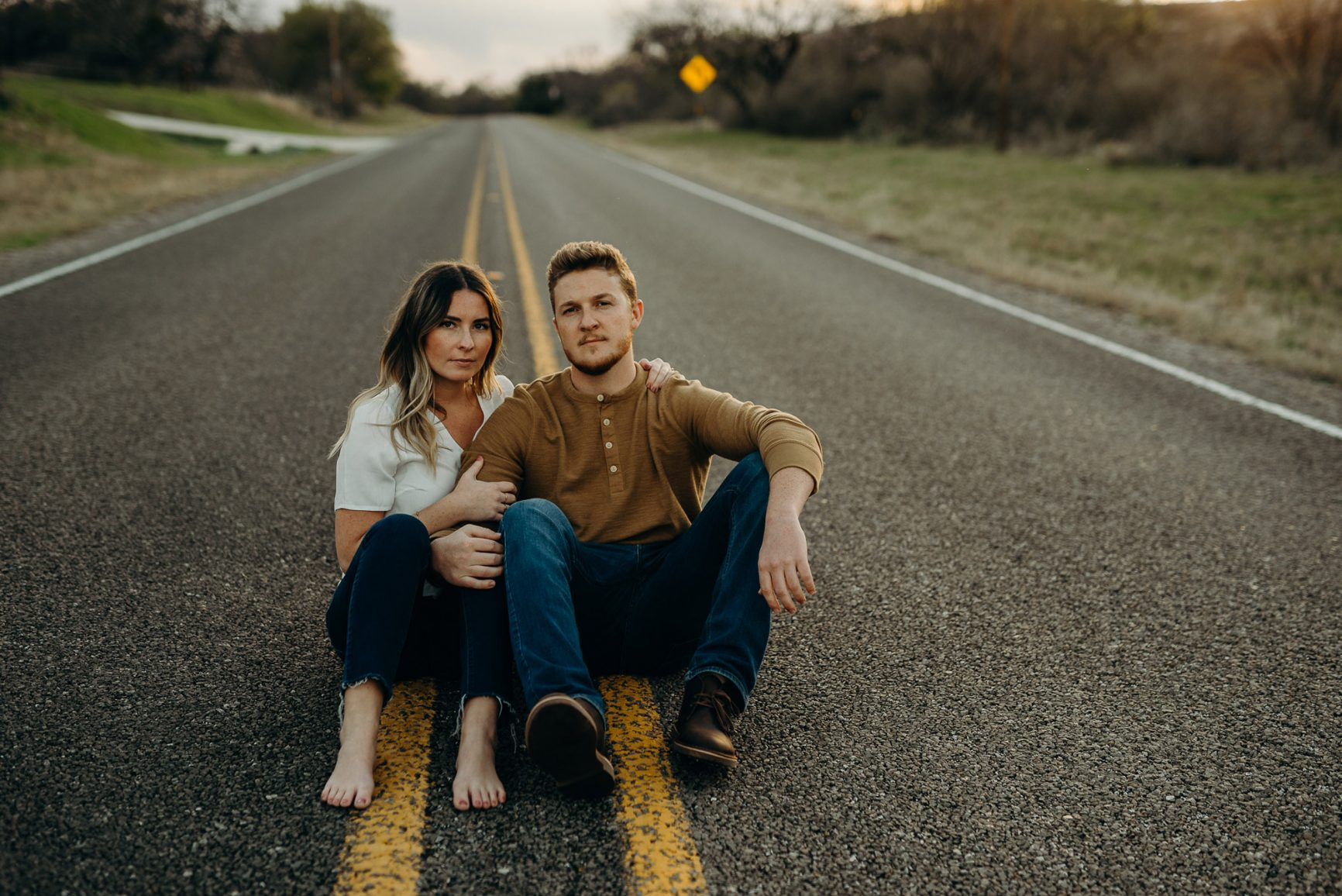 engagement photo couple in the middle of road