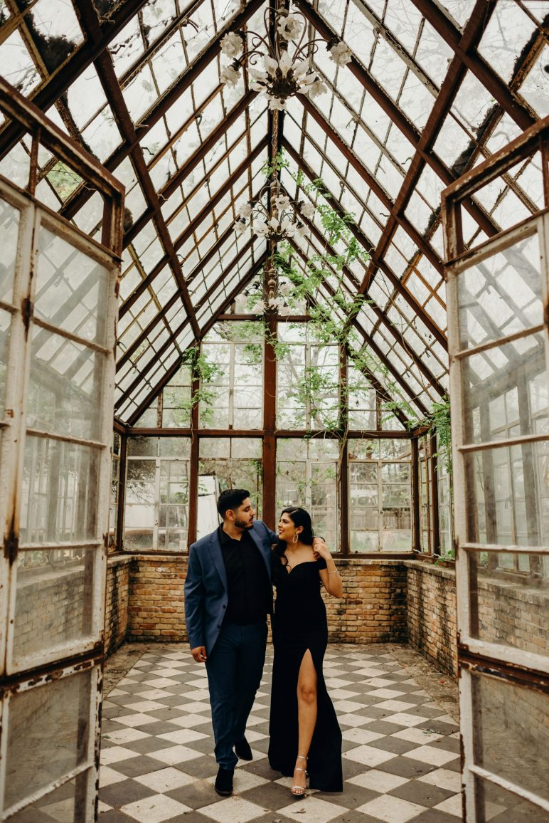 engaged couple in greenhouse